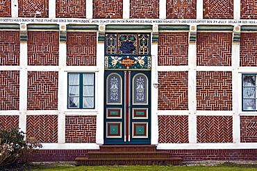 Historic timber-framed house, ornate entrance door, detail, old farmhouse, Neuenfelde, Altes Land area, fruit cultivation, Harburg district, Hamburg, Germany, Europe