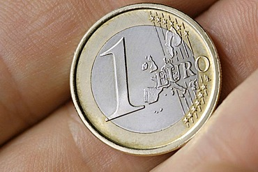 1 Euro coin in a hand