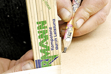 Scribing, marking with yard stick and pencil, Carpentering
