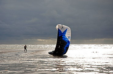 Kite surfer at the beach, St Peter Ording, Schleswig-Holstein, Germany