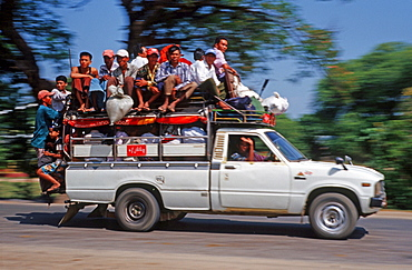 Overcrowded car, people on the roof, Burma, Asia