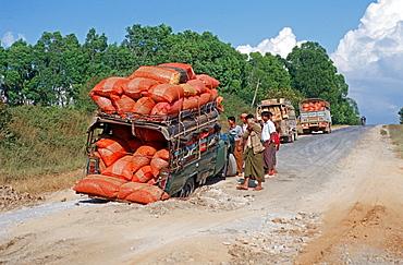 Cramped pickup with broken axle, Burma, Asia