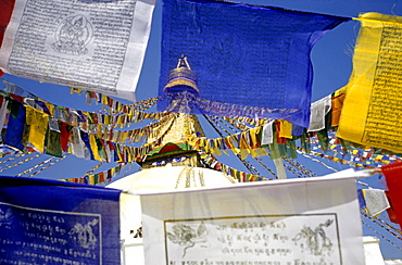 "Prayer flags and view of the ""all-seeing eyes of the Buddha, "" Bodnath, Nepal, Asia"