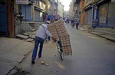 Nepalese man bringing eggs to the market, Kathmandu, Nepal, Asia