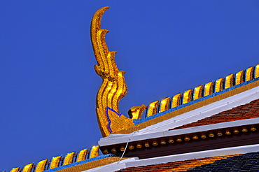 Roof detail: Chofah (Sky Tassell) at Phra Mondhop (library) in Wat Phra Kaeo (Temple of the Emerald Buddha) Grand Palace, Bangkok, Thailand, Southeast Asia, Asia
