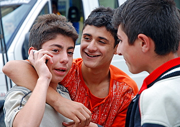 Boys talking on a mobile phone, Yusufeli, Kackar Mountains, northeastern Anatolia, Turkey, Asia