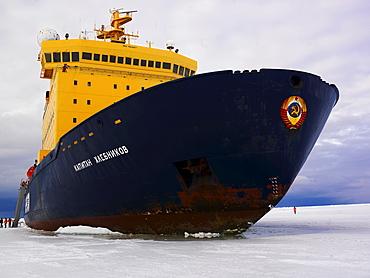 The Captain Khlebnikov icebreaker moored in ocean ice in McMurdo Sound, Antarctica