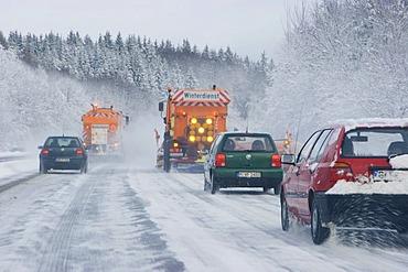 Road service in winter snowploughs on highway Bavaria Germany