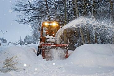 Snow blower at driving snow Bavaria Germany