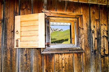Cabin detail, window reflection, Dolomites, Italy, Europe