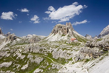 View of Mt. Tre Cime di Lavaredo (German: Drei Zinnen), cabin and hiking trails, Dolomites, Italy, Europe