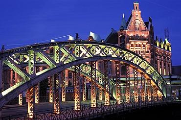 Warehouse district , Hamburg , Germany , Europe : Illuminated facades at night , bridge