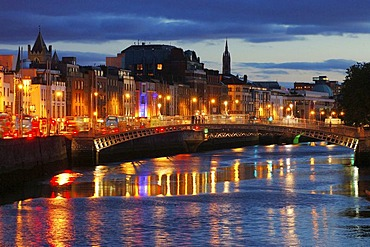 Temple Bar district on the left side of the Liffey River . City view in the dusk . Dublin , Ireland , Europe