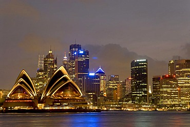 City view with Sydney Opera House at night, Port Jackson, Sydney Harbour, is the largest natural harbour in the world, Sydney, New South Wales, Australia