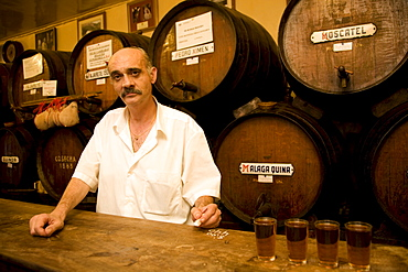 Waiter Juan keeping tab using chalk on the bar in Antigua Casa de Guardia, sherry barrels behind him, bodega in Malaga, Andalusia, Spain, Europe