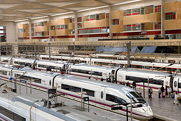 AVE high-speed bullet trains waiting at the platforms of the Estacion de Delicias train station in Saragossa or Zaragoza, Aragon, Spain, Europe