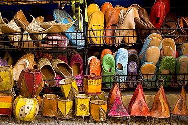 Colourful Moroccan sandals and lamps for sale as souvenirs in Caldereria Nueva Street, Granada, Andalusia, Spain