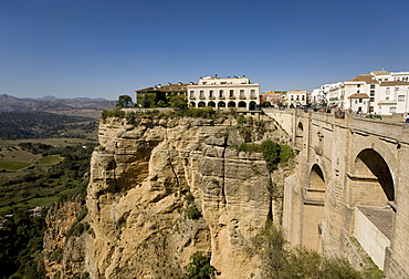 Parador Hotel, Parador De Ronda, in the historic city centre on a rock plateau in the Serrania de Ronda, at the front a bridge over the River Tajo, Ronda, Andalusia, Spain, Europe