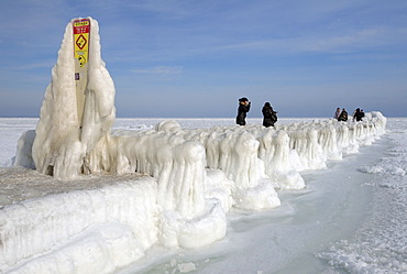 People on icy pier, frozen Black Sea, a rare phenomenon, Odessa, Ukraine, Eastern Europe