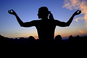 Woman doing yoga in the evening, Kalk Alps National Park, Upper Austria, Austria, Europe