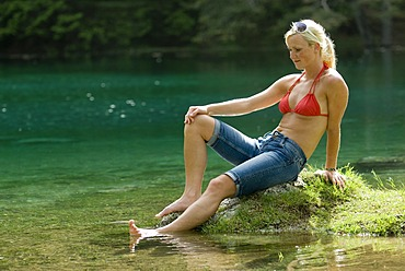 A woman at a lake
