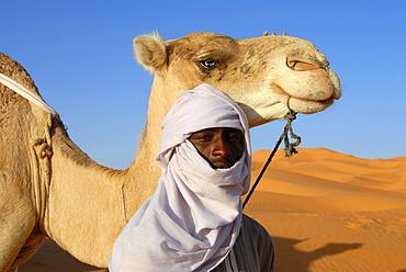 Tuareg with camel in sanddunes Mandara Libya