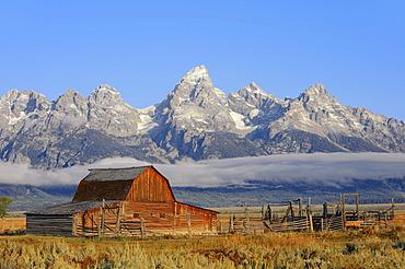Old barn in front of Teton Range, Grand Teton National Park, Wyoming, USA