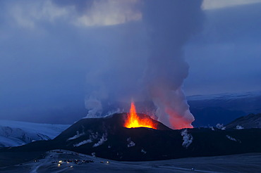 People and super jeeps at a lookout point during the eruption of the volcano Fimmvoer√∞uh√°ls, Fimmvoerduhals, between M√Ωrdalsjoekull and Eyjafjallajoekull, Highlands, Iceland, Europe