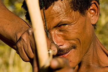 Bushman, San, with bow and arrow, near Andriesvale, Kalahari Desert, Northern Cape, South Africa, Africa