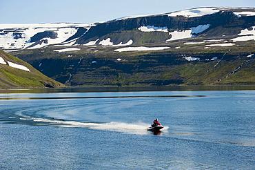 Speedboat near the village of Hesteyri, Hesteyrarfjoer√∞ur, Hesteyrarfjoerdur Fjord, Hornstrandir, Westfjords, Iceland, Europe