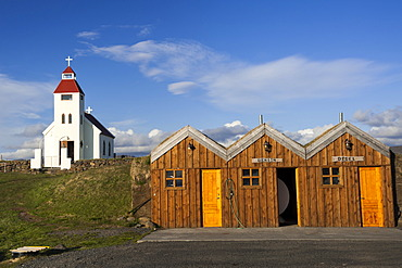 The church and a petrol station in a wooden hut, Moe√∞rudalur, Highlands of Iceland, Iceland, Europe