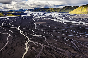 Aerial view, moss-covered mountains and the black sand of Mælifellssandur Desert, Icelandic Highlands, Iceland, Europe