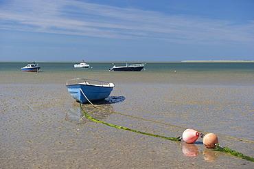 Blue rowing boat on the beach of Utersum, Foehr island, North Frisia, Schleswig-Holstein, Germany, Europe