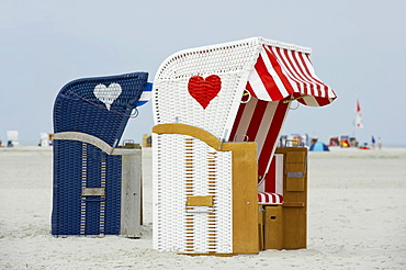 Roofed wicker beach chairs with hearts, Kniepsand at Norddorf, Amrum, North Frisia, Schleswig-Holstein, Germany, Europe