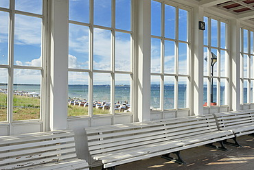 Looking through the window of the pavilion of the Kurhaus spa building towards the Baltic Sea and the beach, Baltic Sea resort town of Binz, Binz, Rügen, Mecklenburg-Western Pomerania, Germany