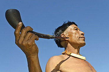 Man of the Samdom tribe with a pipe, at the annual Hornbill Festival, Kohima, Nagaland, India, Asia