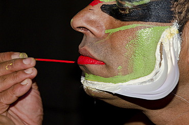 The make-up of the Kathakali character Jayantha is being applied, Varkala, Kerala, India, Asia