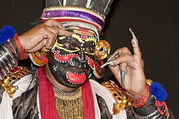 The make-up of the Kathakali character Nakrathundi is being applied, Varkala, Kerala, India, Asia