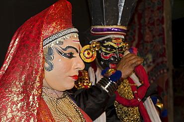 Leleda and Nakrathundi on stage at a Kathakali performance in Varkala, Kerala, India, Asia