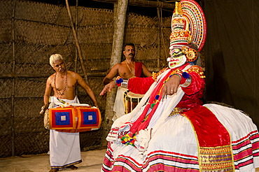 The Kathakali character Ravana on stage at Kolornagerkavu-Mandir in Perratil, Kerala, India, Asia