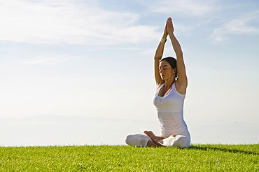 Young woman practising Hatha yoga outdoors, showing the pose merudandasana, sitting mountain pose, Nove Mesto, Okres Teplice, Czech Republic, Europe