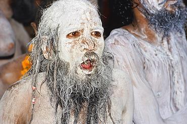 Ash-smeared face of a Shiva sadhu, Varanasi, Uttar Pradesh, India, Asia