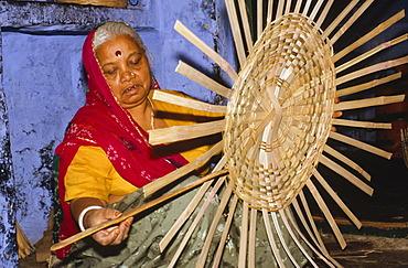 Local woman making basket from bamboo, Jodhpur, Rajasthan, India, Asia