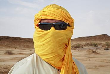 Tunisian in Arabian clothes, Sahara, Tozeur, Tunisia