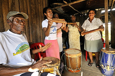 Neighbors from the traditional Afro-Colombian community meet to make music, Bajamar slum, Buenaventura, Valle del Cauca, Colombia, South America