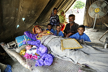 Family with newborn baby, they have been living in a tent since the flood disaster of 2010, Lashari Wala village, Punjab, Pakistan, Asia