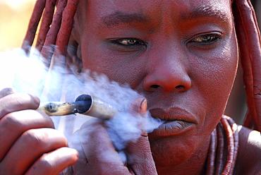 Smoking Himba women, Purros, Kaokoveld, Namibia