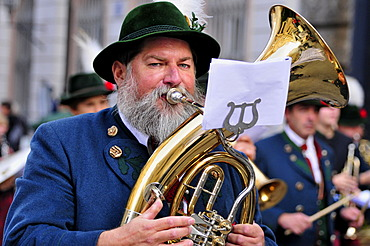 Musician in garb at the Oktoberfest\'s traditional costume procession, Munich, Bavaria, Germany, Europe