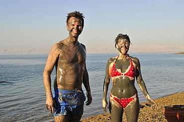Tourists smeared with salty mud from the Dead Sea, near Suwaymah, Jordan, Middle East, Orient