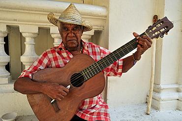 Street musician, busker, guitarist, Santiago de Cuba, Cuba, Caribbean